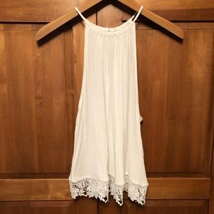 Divided White Sleeveless Flowy Top with Lace